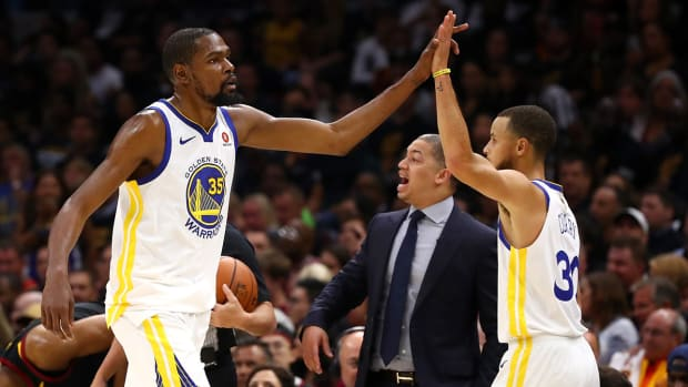 kd_and_steph_high_5_during_game_4.jpg