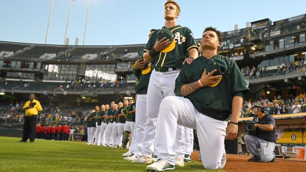 bruce-maxwell-national-anthem-kneel-protest.jpg