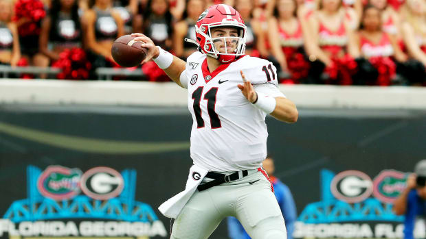 Nov 2, 2019; Jacksonville, FL, USA; Georgia Bulldogs quarterback Jake Fromm (11) throws the ball against the Florida Gators during the first half at TIAA Bank Field. Mandatory Credit: Kim Klement-USA TODAY Sports