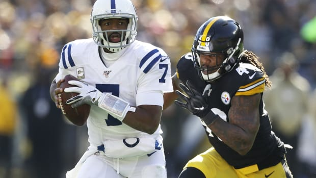 Indianapolis Colts quarterback Jacoby Brissett tries to avoid the Pittsburgh Steelers pass rush in Sunday's road game at Heinz Field.