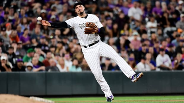 Sep 16, 2019; Denver, CO, USA; Colorado Rockies third baseman Nolan Arenado (28) throws the ball against the New York Mets in the eighth inning at Coors Field. Mandatory Credit: Ron Chenoy-USA TODAY Sports