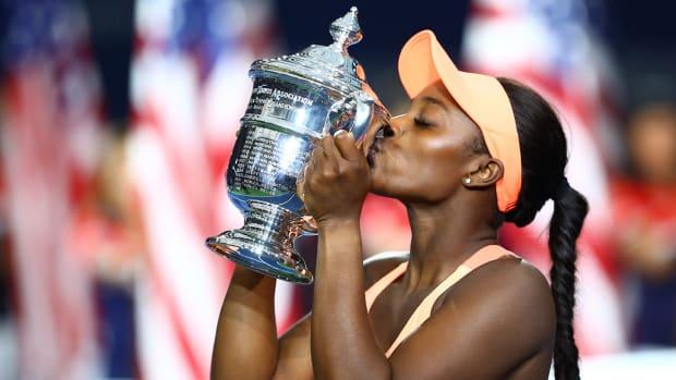 sloane-stephens-us-open-trophy-kiss-lead.jpg