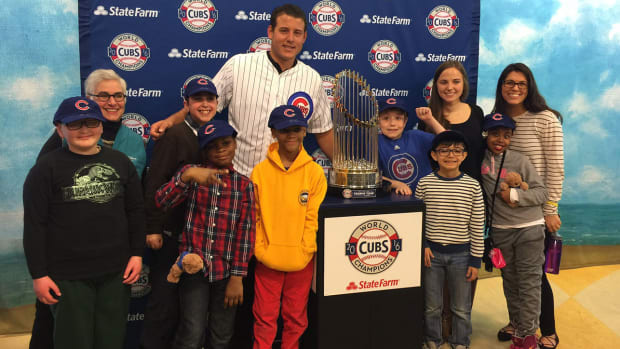 anthony-rizzo-visits-hospital-world-series-trophy.jpg