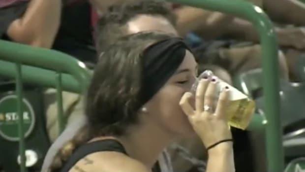 fort-wayne-tincaps-fan-foul-ball-beer-chug-video.png