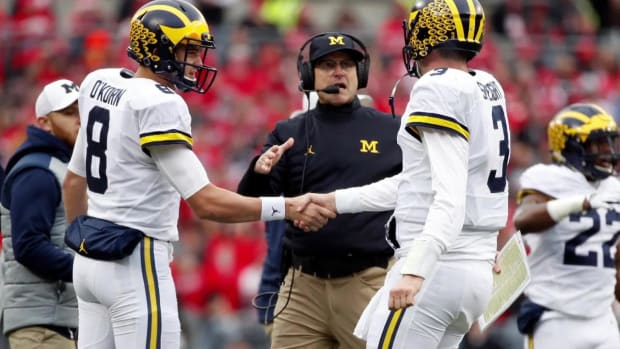 #DearAndy: Over/under on total wins by Jim Harbaugh over Urban Meyer?
