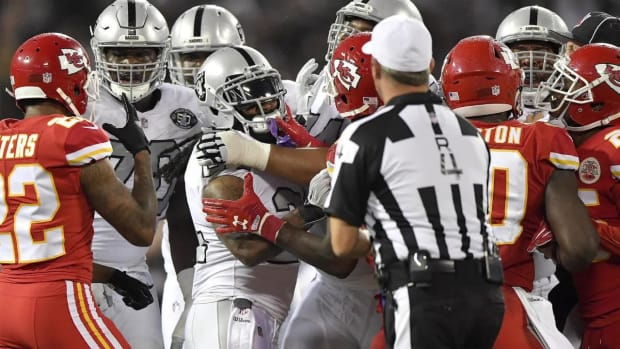 Donald Penn Says Marshawn Lynch Left Bench to Protect Marcus Peters - IMAGE