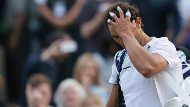 Rafael Nadal loses to Gilles Muller in five-set thriller at Wimbledon - IMAGE