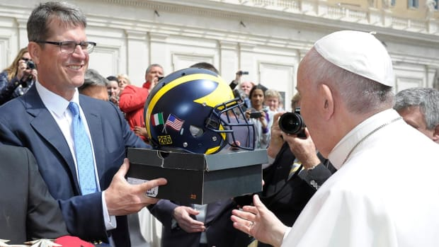 Jim Harbaugh gave Pope Francis some Michigan gear - IMAGE