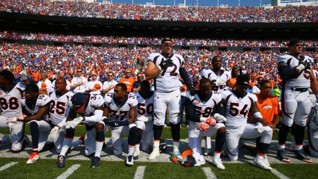 broncos-players-kneel.jpg