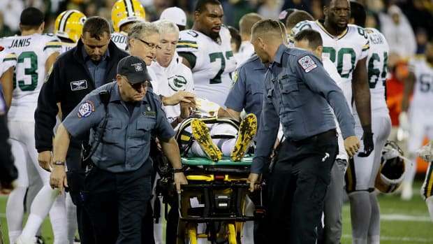davante_adams_gets_carted_off_three_and_out.jpg
