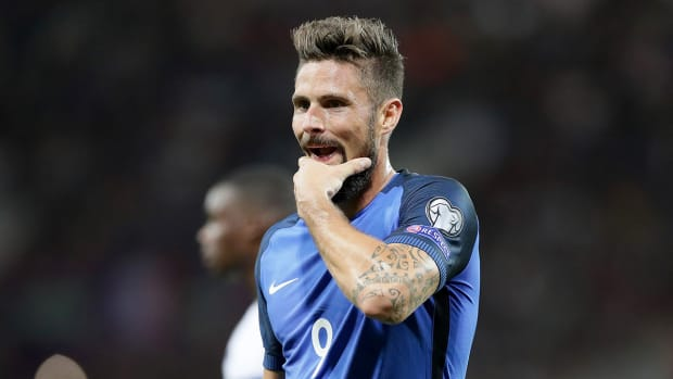 giroud_reacts_after_france_are_held_to_scoreless_draw_against_luxembourg.jpg