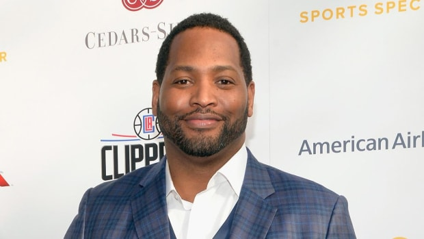 Robert Horry Scuffles with Heckler at Son's Basketball Game - IMAGE