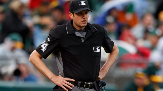 Umpire saves woman's life--IMAGE