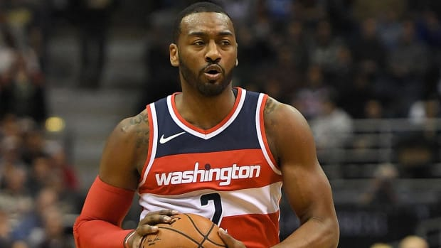 Wizards' John Wall Expected to Miss Two Weeks With Injured Knee--IMAGE
