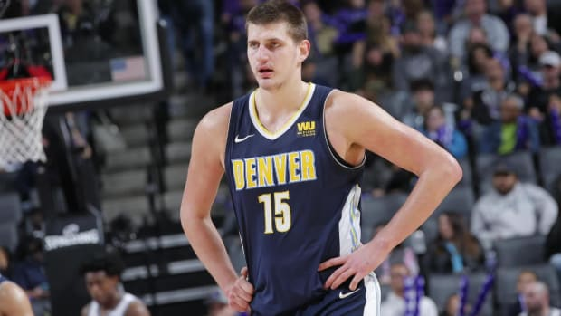 Report: Denver Nuggets Star Nikola Jokic out 'Several Games' With Left Ankle Sprain - IMAGE