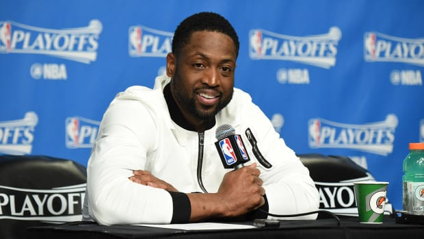 d_wade_takes_buyout_from_bulls.jpg