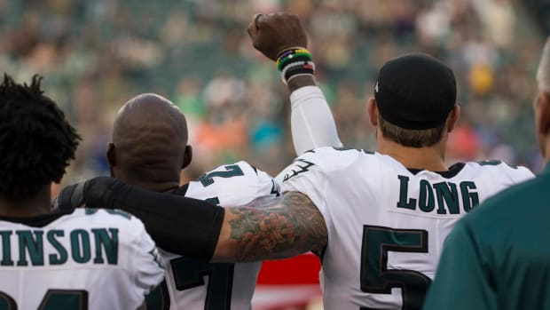 Chris Long Puts Arm Around Teammate Malcolm Jenkins in Support During Anthem Protest - IMAGE