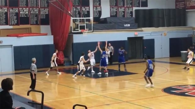 High school basketball player makes miraculous shot--IMAGE