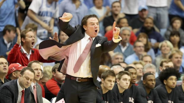 Rick Pitino restrained after verbal exchange with UNC fan - IMAGE