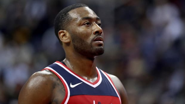 John Wall Injures Shoulder in Loss to Cavaliers--IMAGE
