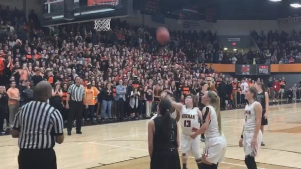 Special needs student makes basket in high school basketball game--IMAGE