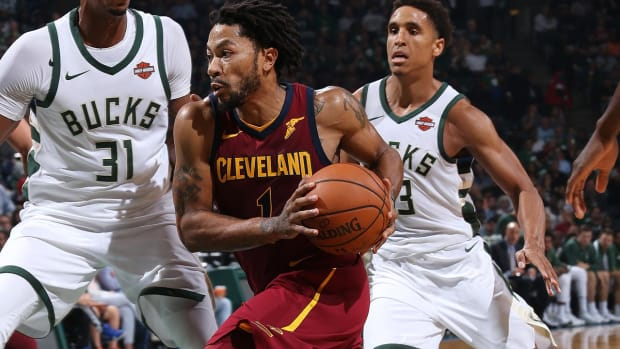 Derrick Rose Injures Ankle, Lue Says It 'Doesn't Look Good'--IMAGE