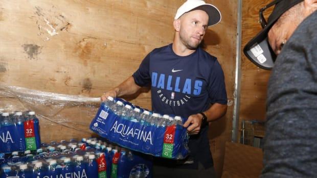 NBA Star J.J. Barea Makes Rescue Mission to Native Puerto Rico--IMAGE