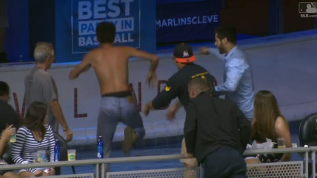 marlins-fan-pool-dive-marcel-ozuna-home-run-video.png