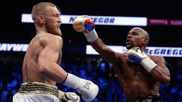 mayweather-mcgregor-punch-boxing-1300.jpg