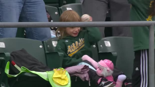oakland-athletics-angels-fan-child-foul-ball-throw-video.png