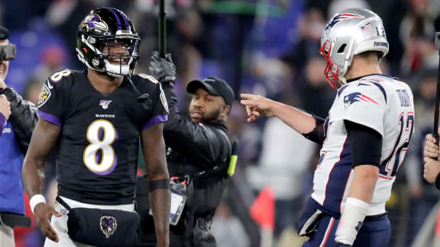 Tom Brady and Lamar Jackson before a Patriots-Ravens game