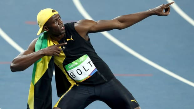 Usain Bolt wins third Olympic gold medal in 100 meters - IMAGE
