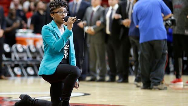 Heat national anthem singer takes knee--IMAGE
