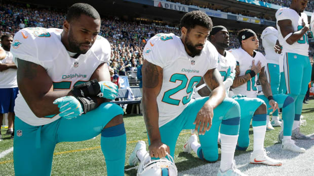 Police union urges sheriffs not to escort Dolphins to stadium over anthem protest IMAGE