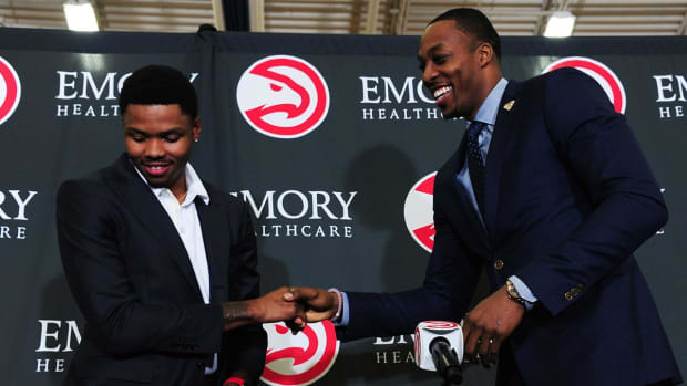 Kent Bazemore, Dwight Howard cry tears of joy during press conference -- IMAGE