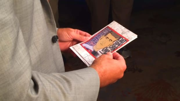 James Bates shows Dabo Swinney the portrait he inspired -- IMAGE