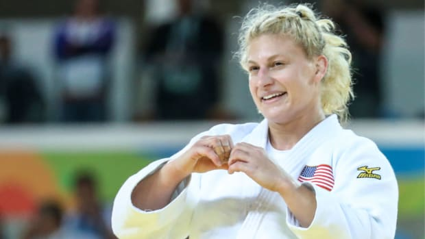 Kayla Harrison celebrates