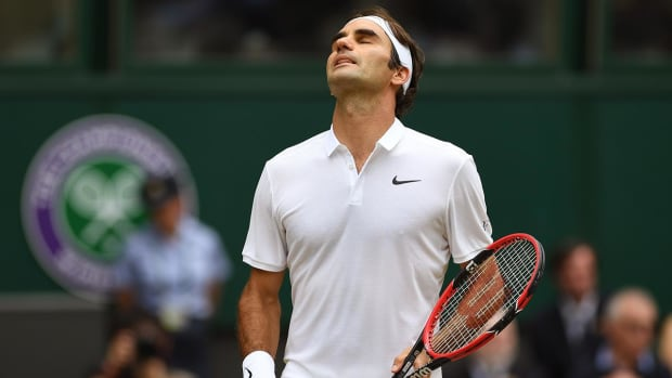 Roger Federer upset by Milos Raonic in Wimbledon semifinal - IMAGE