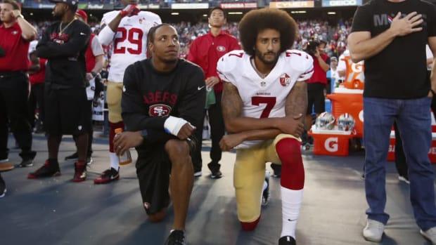 Broncos LB Brandon Marshall kneels during national anthem - IMAGE