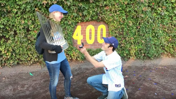 cubs-fan-proposes-wrigley-world-series-trophy-video.png
