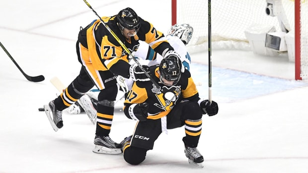 bryan-rust-penguins-score-twice-sharks-conor-sheary-crosby-pass.jpg