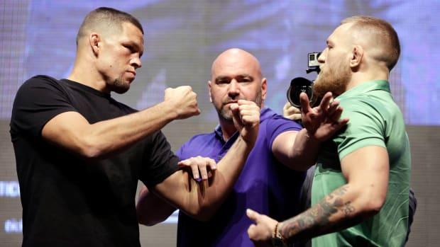 conor-mcgregor-nate-diaz-ufc-press-conference-fight-bottles-video.jpg
