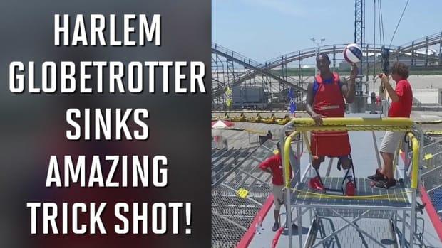Harlem Globetrotter sinks amazing trick shot - IMAGE