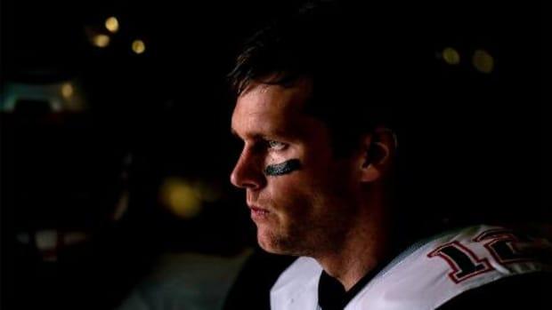 Ndamukong Suh's hit leaves Tom Brady hobbling after game - IMAGE
