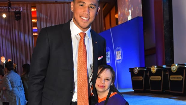 Suns guard Devin Booker brought a special guest to NBA lottery - IMAGE