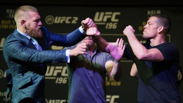 Conor McGregor, Nate Diaz scuffle at UFC 196 press conference -- IMAGE