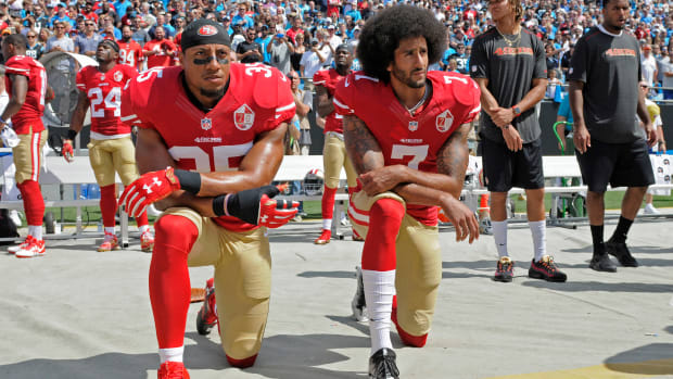 Eric Reid and Colin Kaepernick kneel in 49ers uniforms