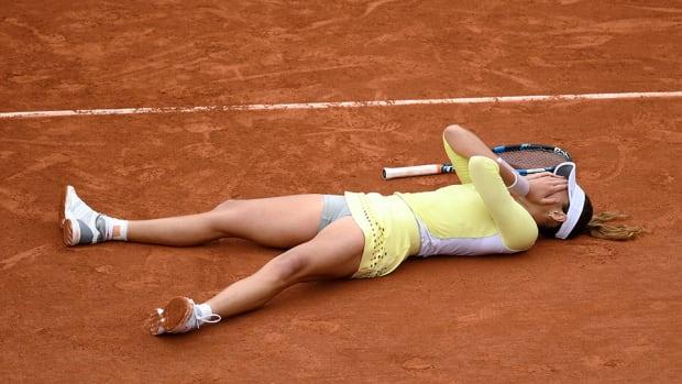muguruza-wins-french-laying-down.jpg