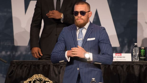 Conor McGregor hands together UFC 205 presser