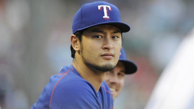 MLB clears Rangers pitcher Yu Darvish of gambling involvement -- IMAGE
